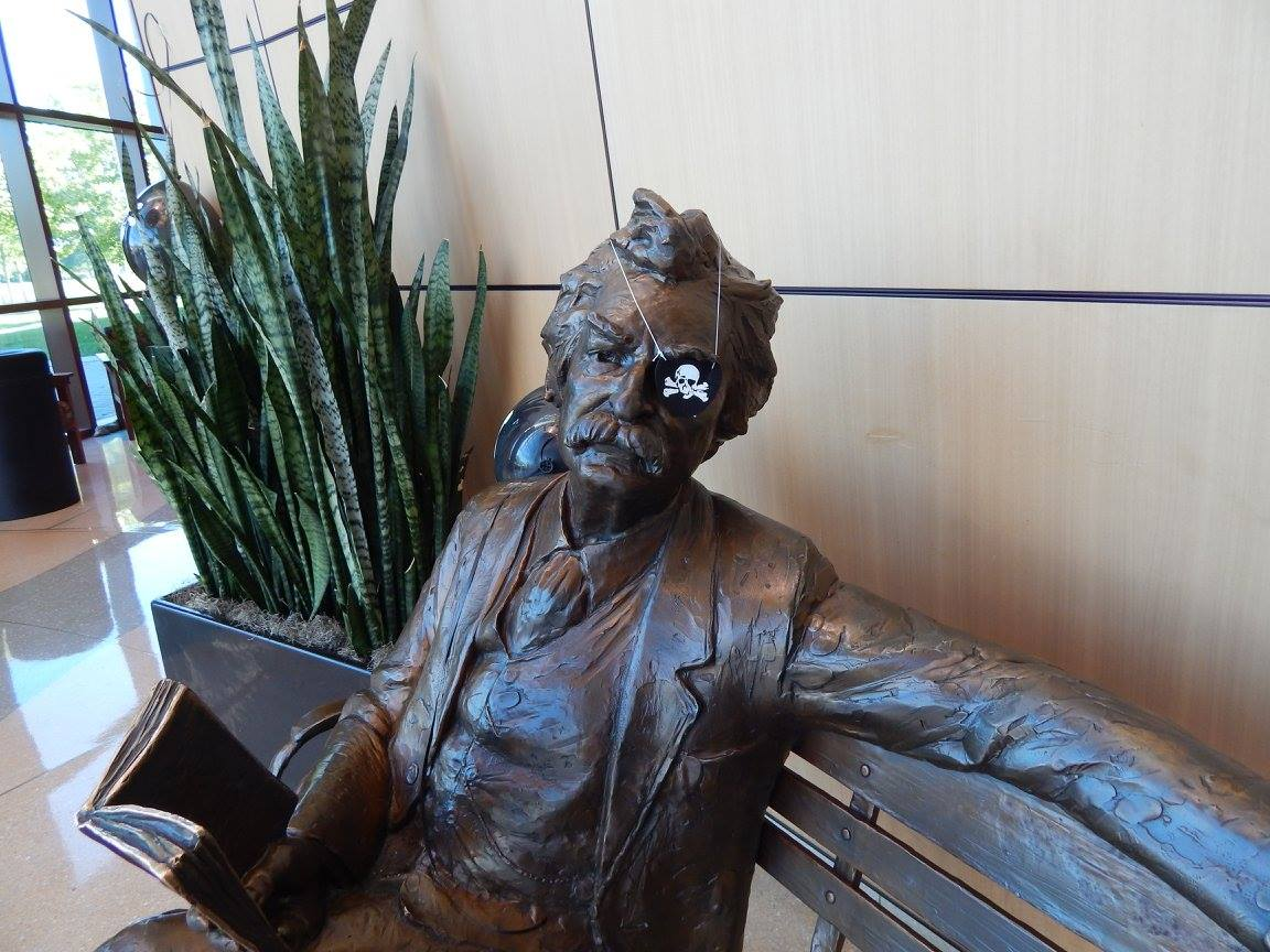 Mark Twain statue with a pirate eye patch