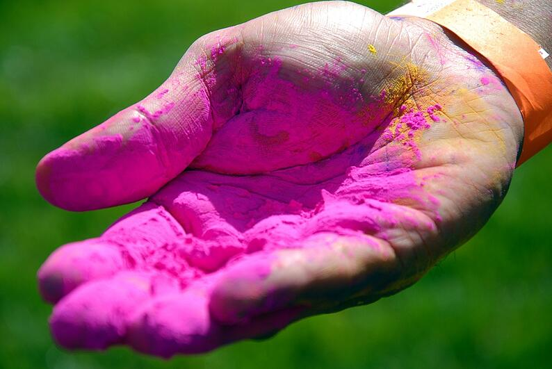 Colored powder in the palm of someone's hand.