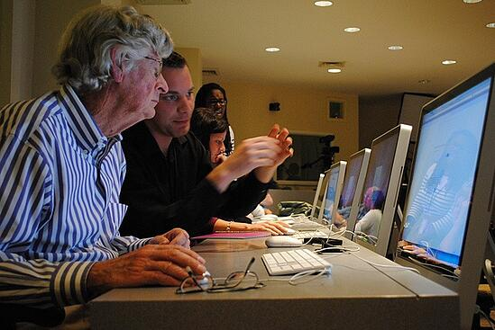 A group of people working on computers together.
