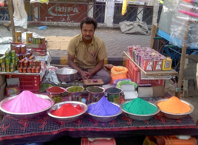 A merchant selling colors for Holi.