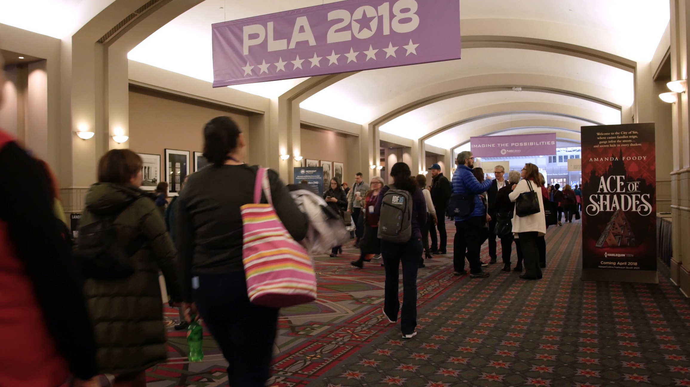 Librarians walking into the PLA 2018 conference.