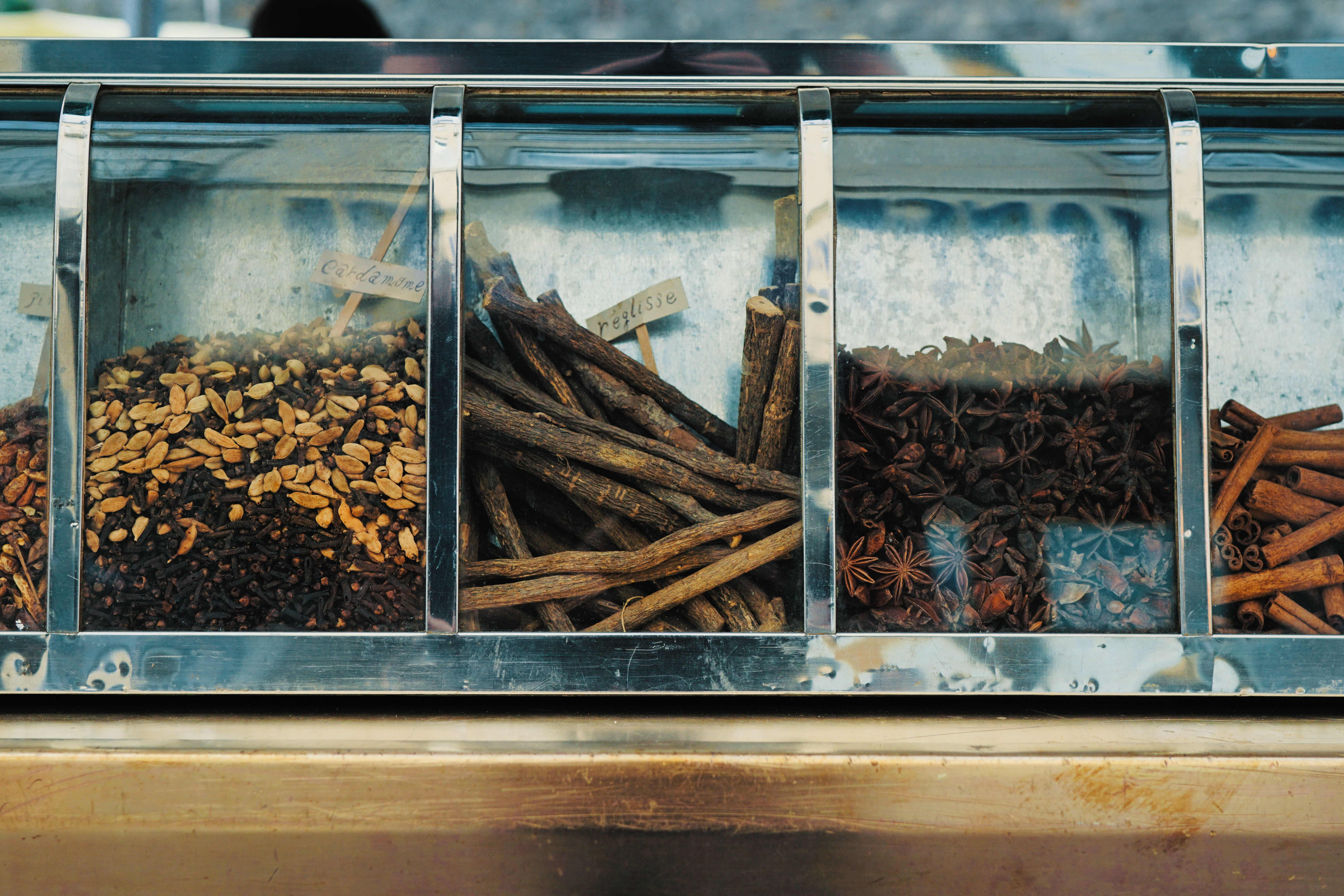 A variety of spices for sale at a market.