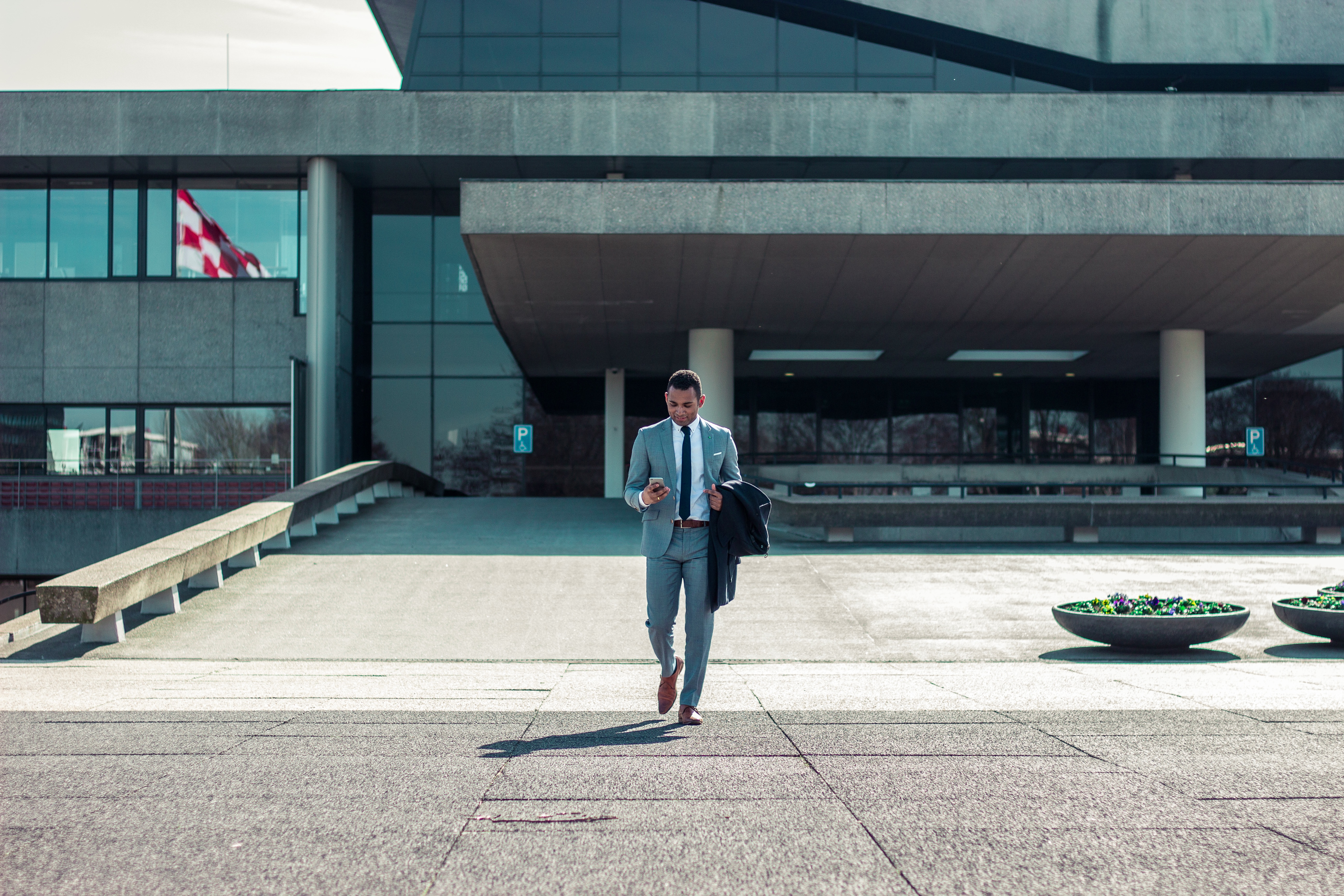 A person in a suit walking out of an office.