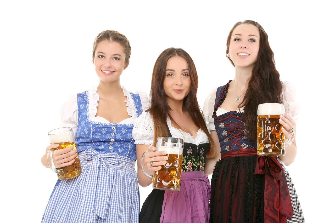 women wearing dirndl and holding beer