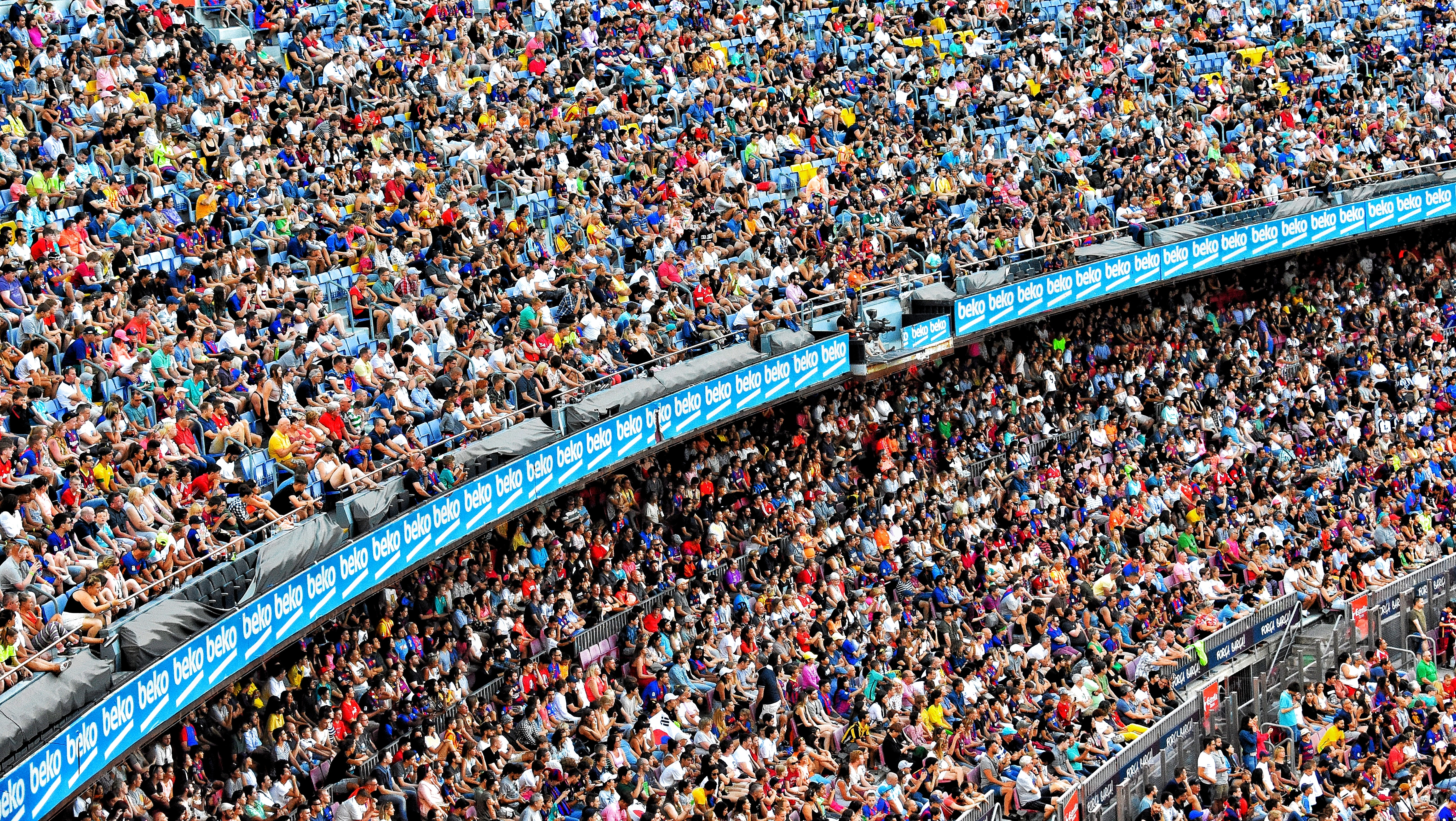 Crowded stadium filled with fans at a sporting event.