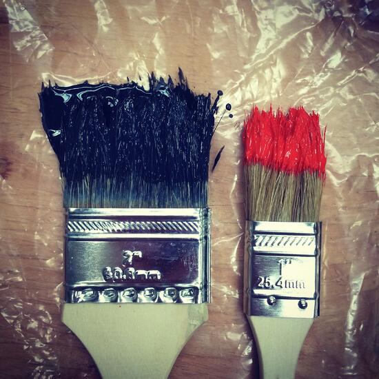 Wet paintbrushes.