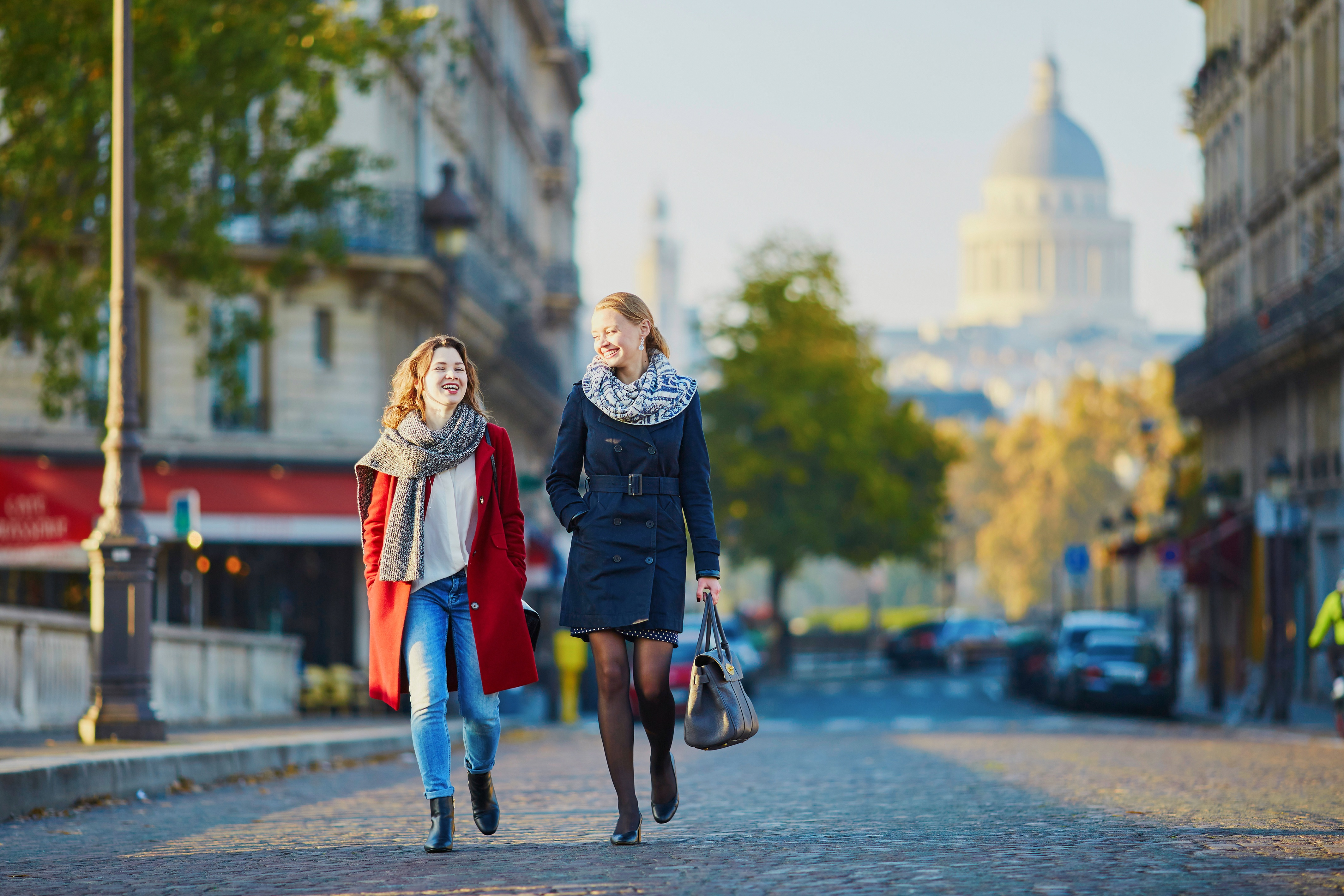 Young women walking in Paris, France speaking French Argot.