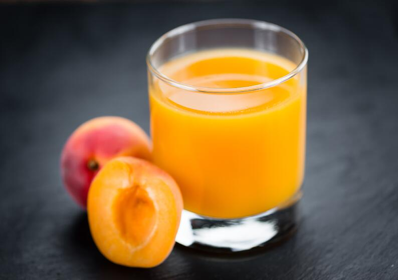 A glass of Syrian apricot juice.