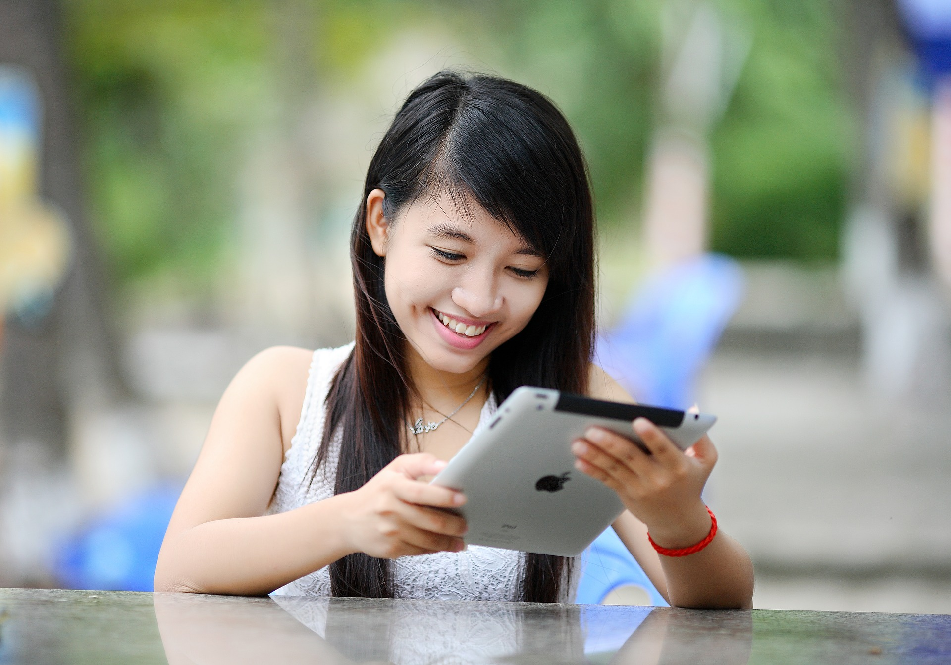 Chinese single girl shopping on tablet.