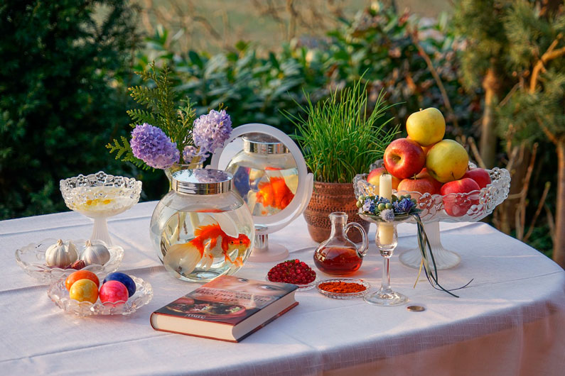 Nowruz traditional table setting with seven items.