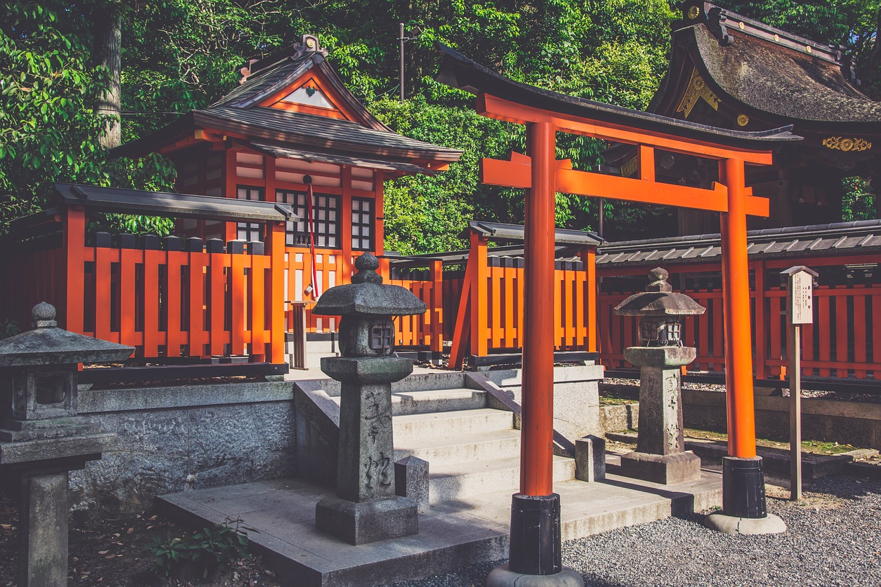 Small japanese temple with tori gate.