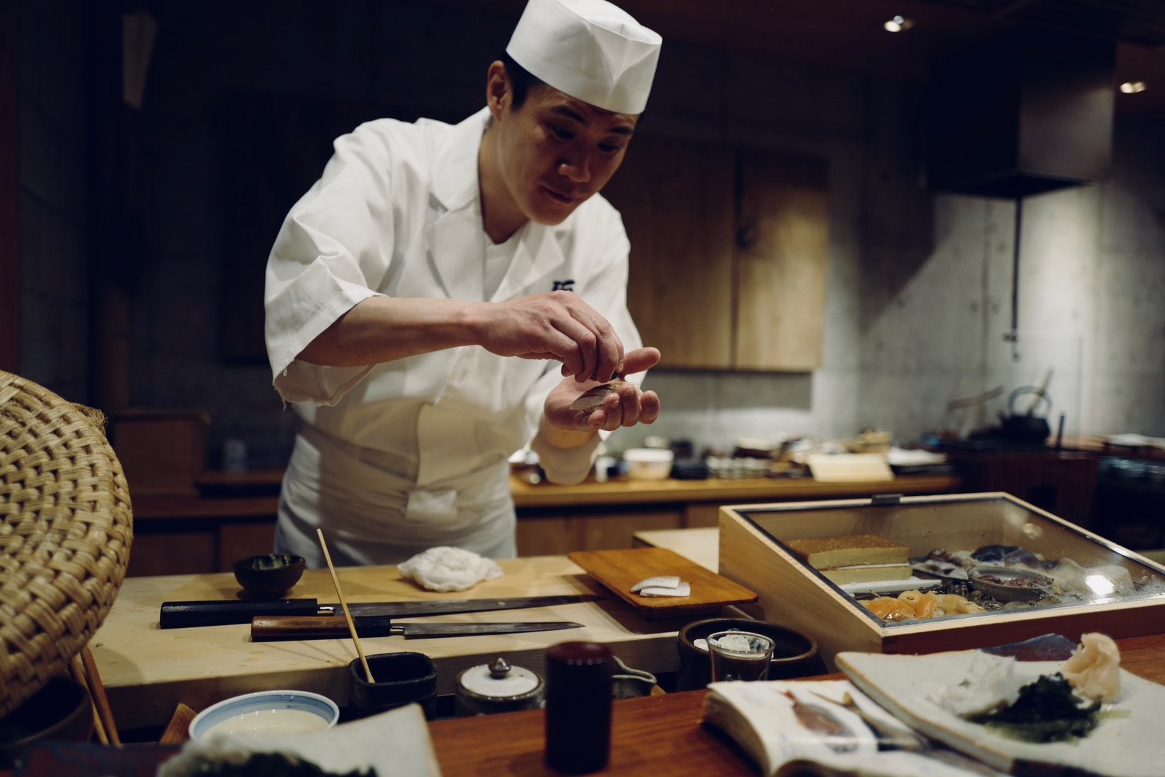 Chef concentrating while preparing Japanese food.