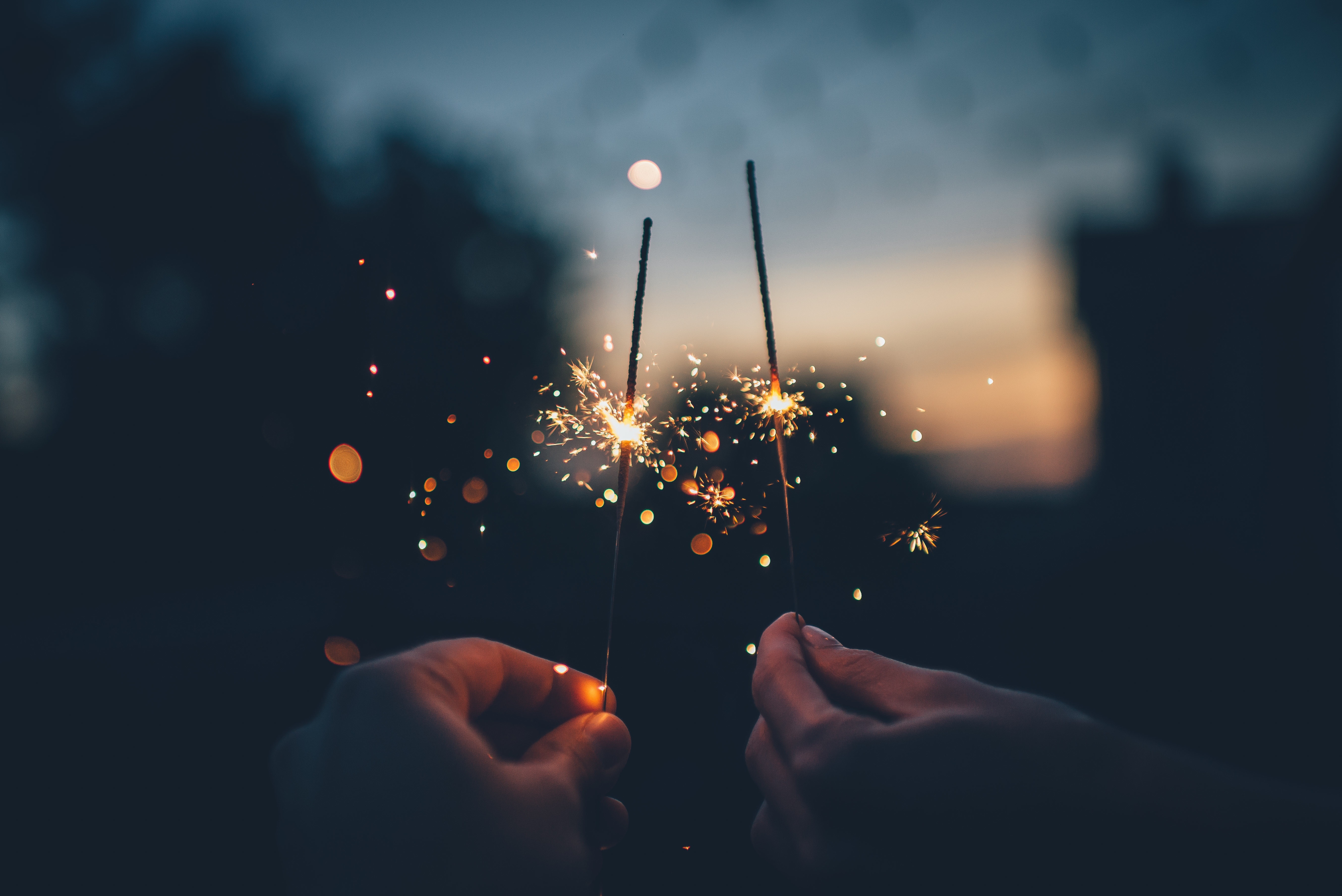 People holding sparklers to ring in New Year.