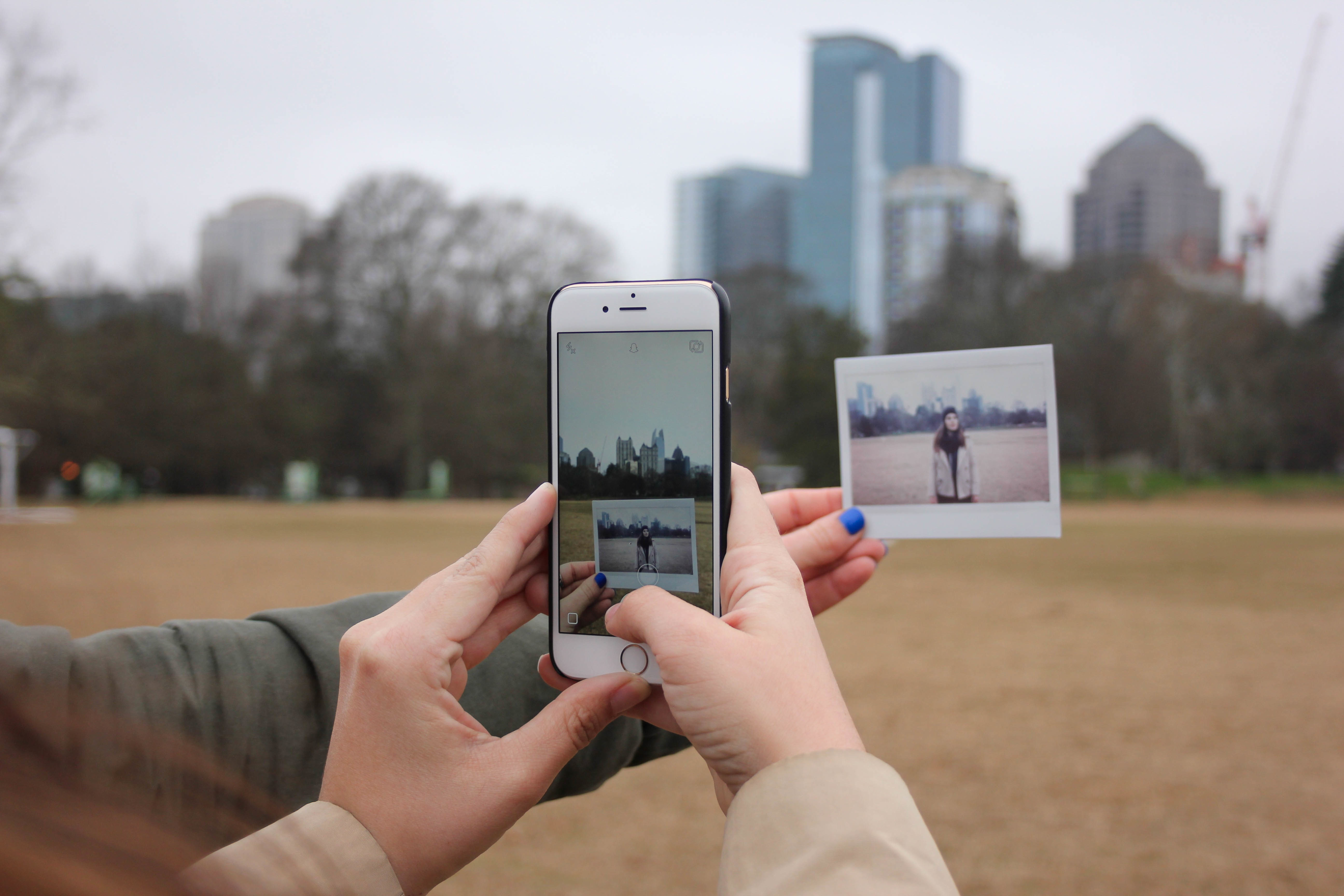 Two people taking a photo to post on social media.