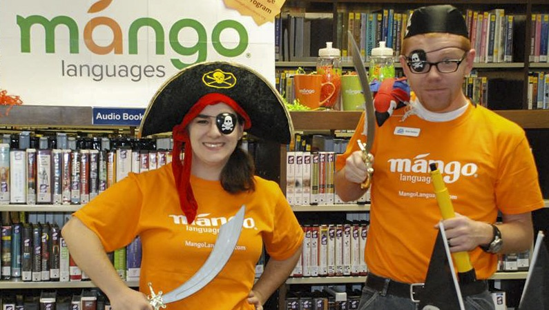 Librarians dressed as pirates to celebrate Pirate Day with Mango Languages.