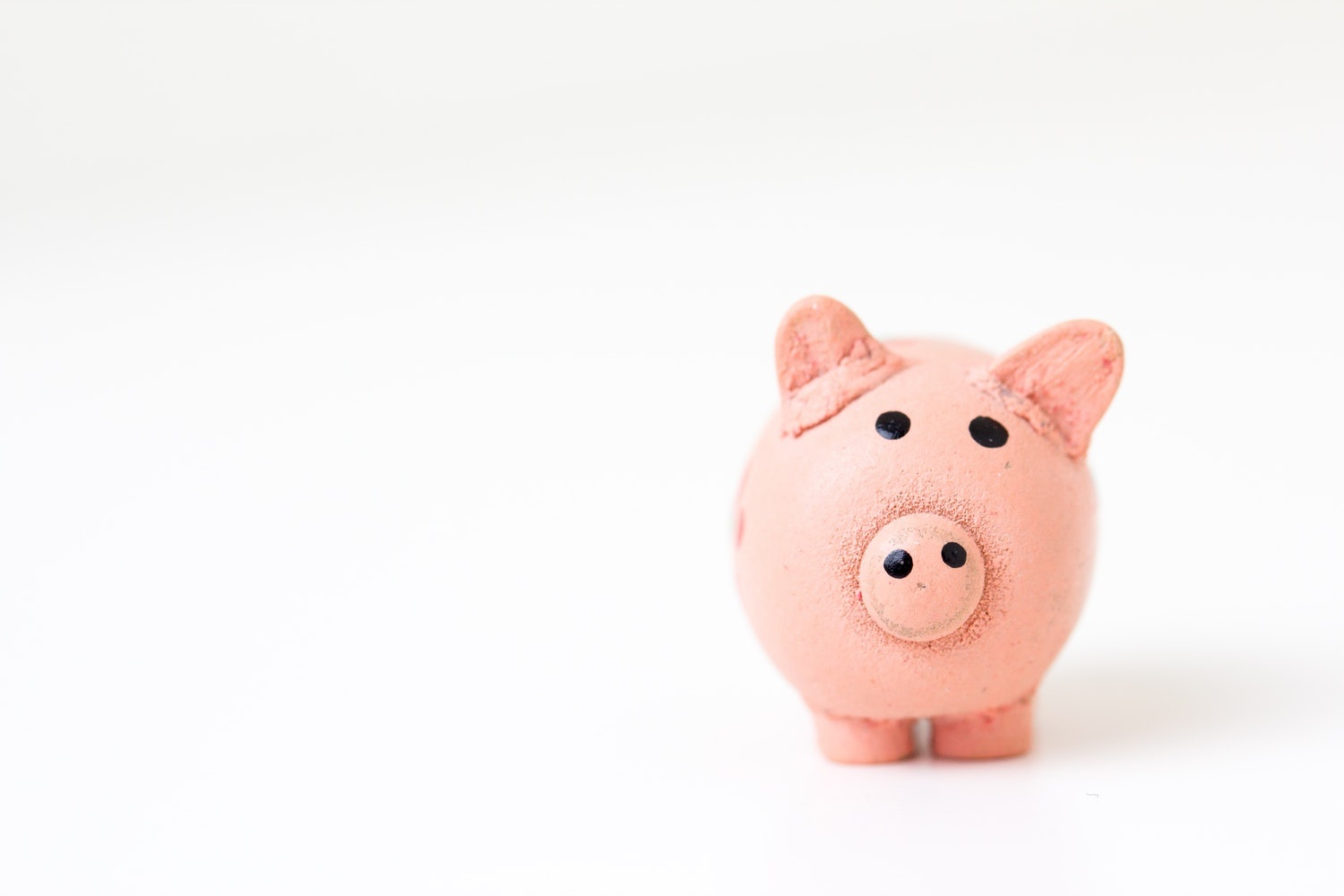 Piggy bank in front of white background.
