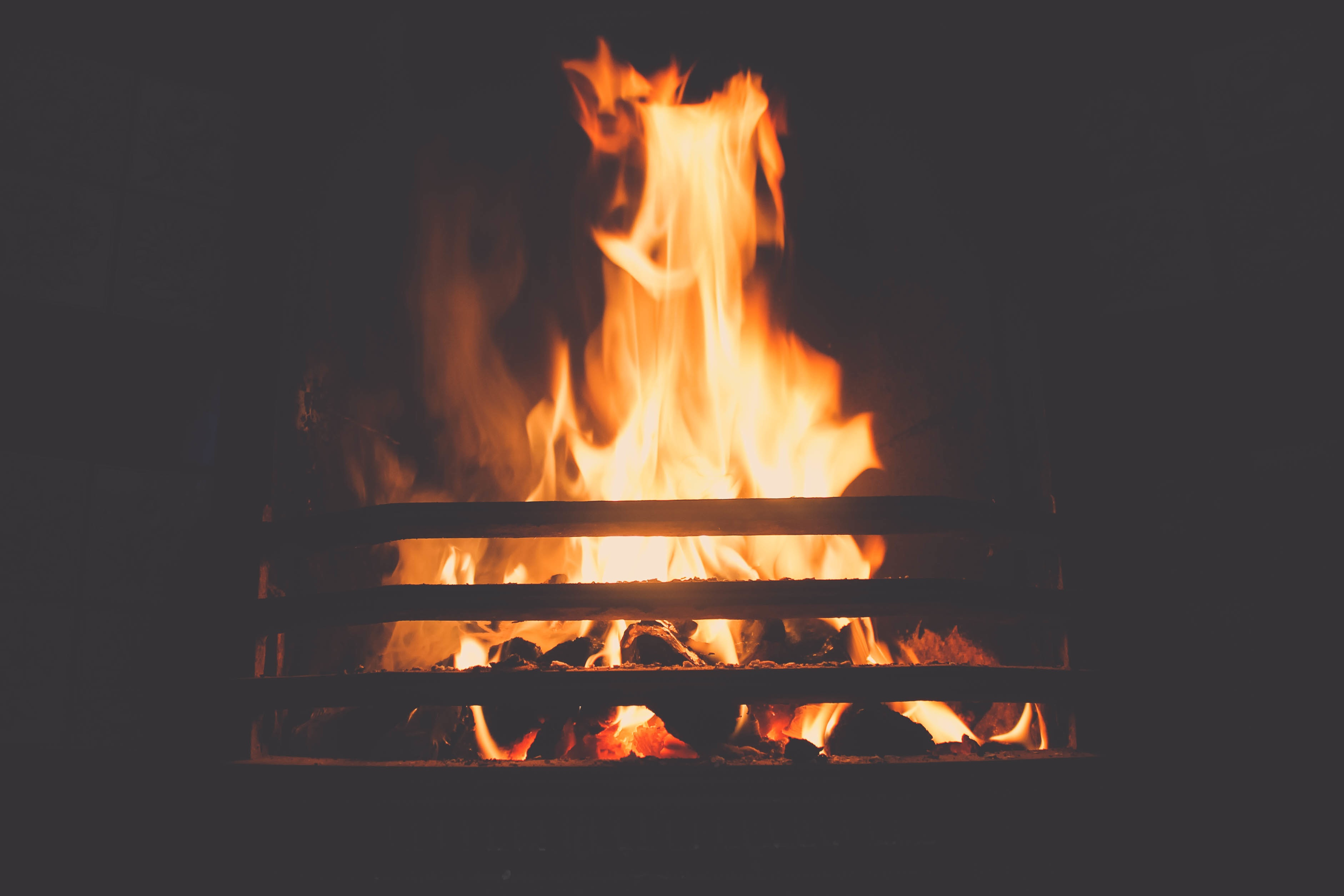 A log burning in a fireplace.