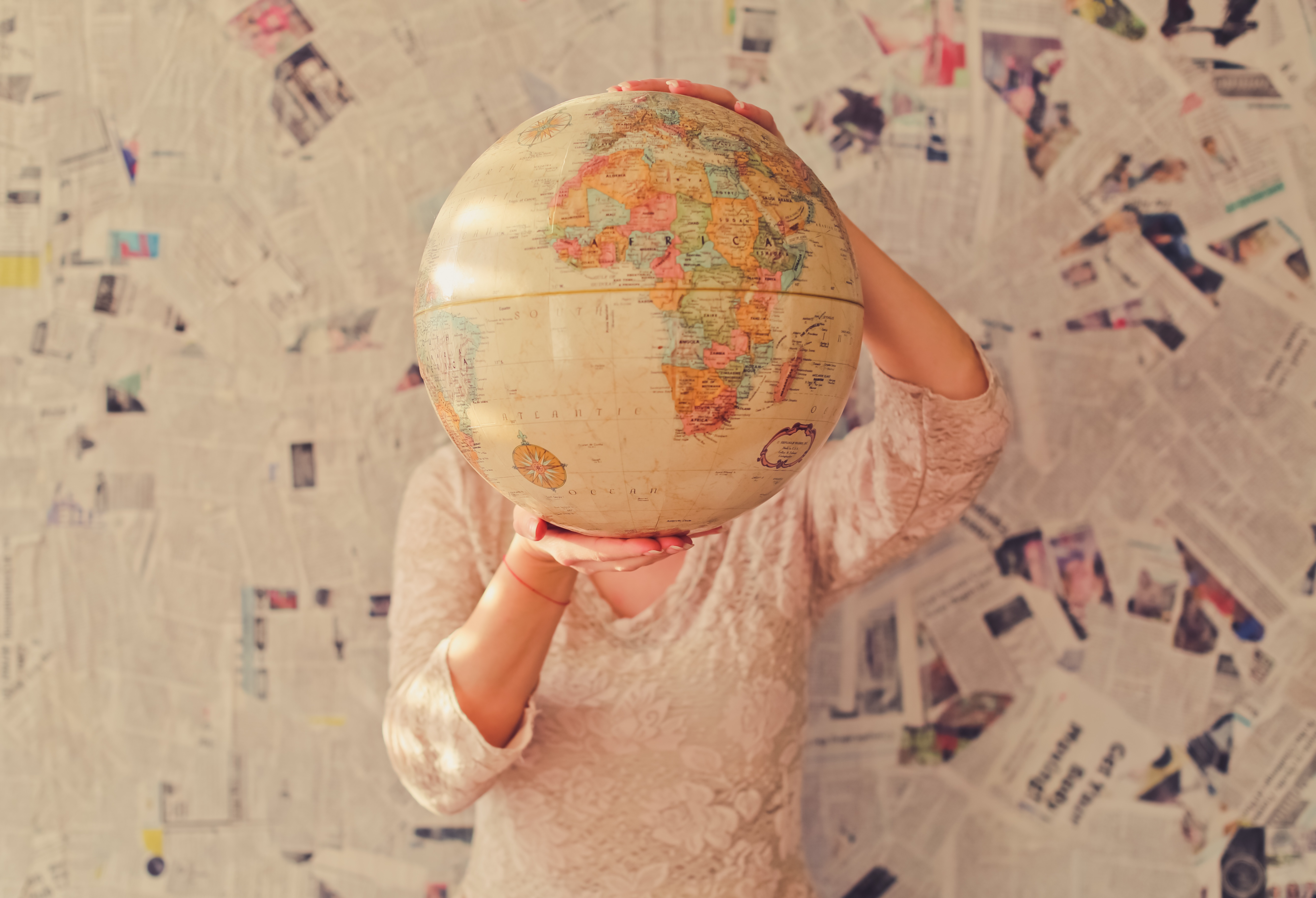 A person holding a globe.