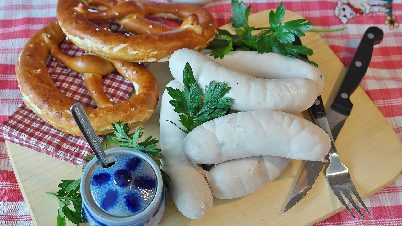 Weisswurst with pretzel on table.