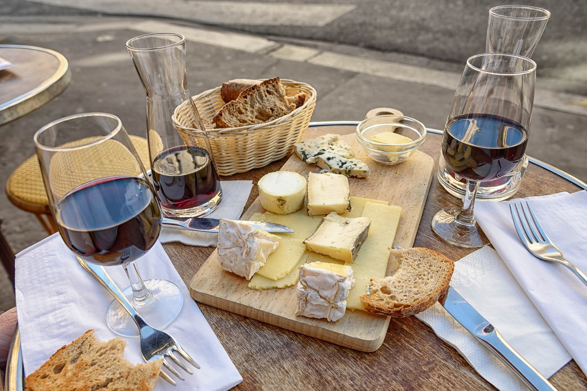 A table of French wine and cheese.