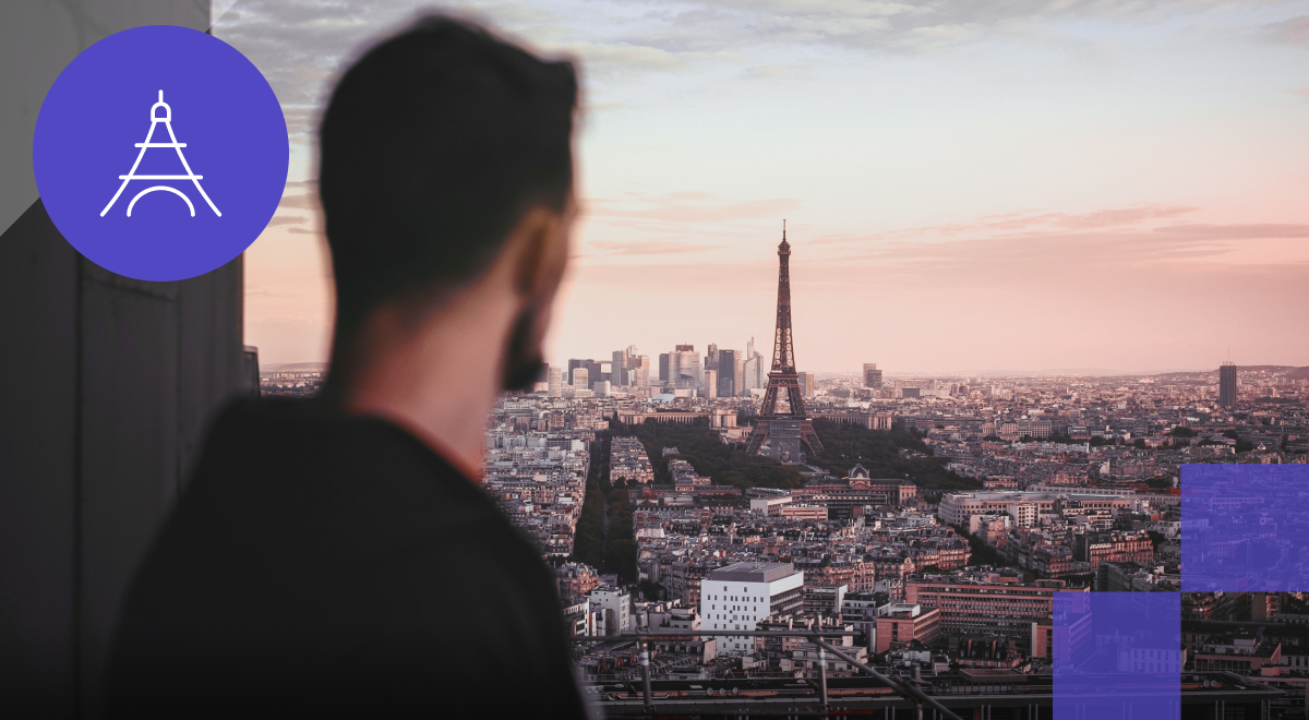 """Mango Languages - French Badge: """"Adventures In Language"""".  Man looking at skyline of France."""