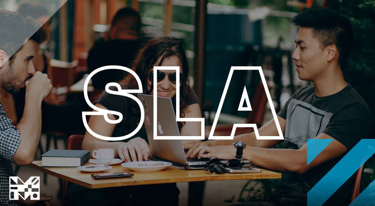 """""""SLA"""" Image of two people sitting at a table."""