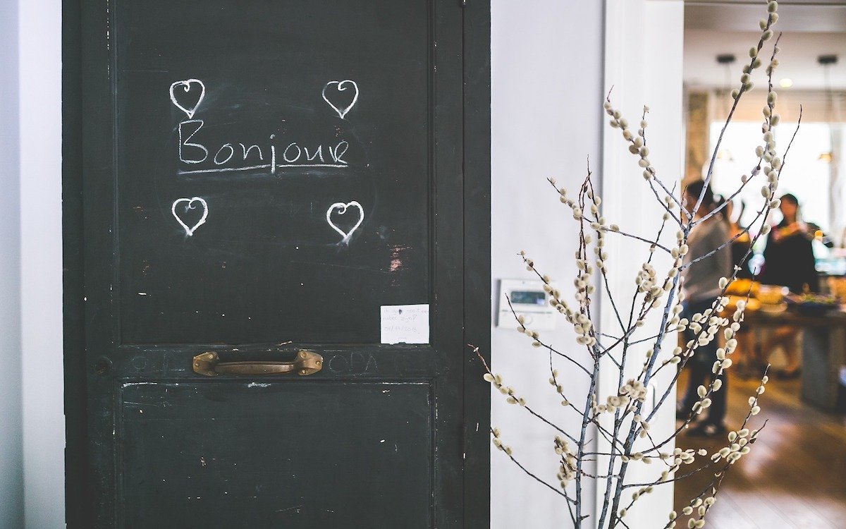 "French word ""Bonjour"" written on a door."